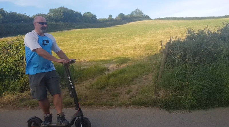 elka model t pro electric scooter being ridden